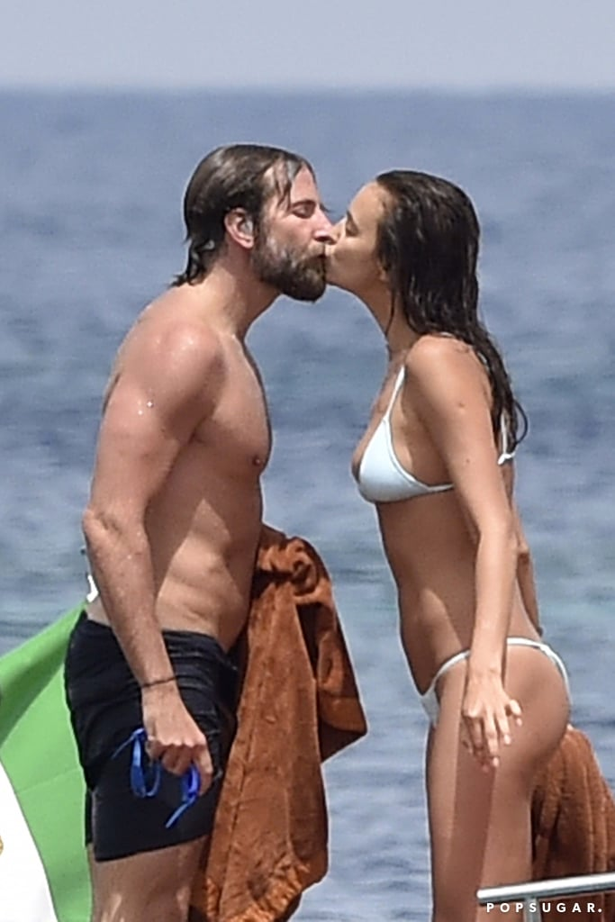 Bradley Cooper and Irina Shayk have not been shy about showing steamy PDA since they first began dating in May 2015, and the couple continued their Summer of love with a stop in the Maddalena Archipelago in Italy last week. Nearly a year after getting hot and heavy on the Amalfi Coast, Bradley and Irina stole a smooch while relaxing on a boat with friends. Irina showed off her figure in a tiny two-piece, and Bradley put his muscles on display in dark trunks; the Sports Illustrated stunner also shared a Boomerang clip of herself jumping into the ocean that day.  Irina and Bradley have been bouncing around Europe for the past few weeks. They popped up in the stands at Wimbledon (and made headlines after Irina was spotted wiping away tears, leading many to believe the two had gotten into an argument) before attending Leonardo DiCaprio's gala in Saint Tropez and soaking up the sun near Lake Garda in Italy.