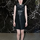 Michelle Dockery's little black leather Miu Miu dress featured an embellished neckline at the designer's show.