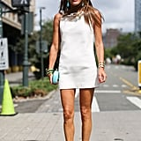 Anna Dello Russo always makes an entrance — and she did it again in an LWD and turquoise accents.