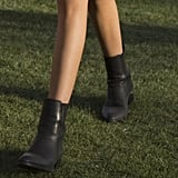 As for footwear, she came ready to walk and dance in practical black ankle boots.