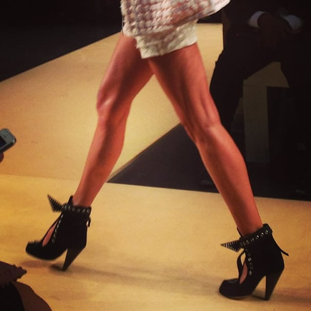 At the Isabel Marant show, the clothes were noteworthy (did you see those ruffled miniskirts?), but let's face it: all eyes were on the shoes. Behold the new It bootie for Spring. Source: Instagram user popsugarfashion