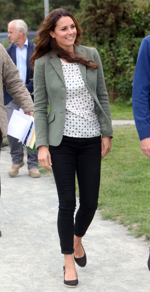 Even though we've seen what new mum Kate Middleton wears running errands at her local grocery store (and have a whole dream wardrobe picked out for her), we had to wait until today to see what she'd wear for her first official engagement since giving birth to Prince George. To kick off a marathon in Wales, she picked skinny black pants, a printed top and Ralph Lauren Blue Label blazer. Her footwear looked comfy (and smart for the outdoor terrain): in lieu of heels, she picked black wedge espadrilles.