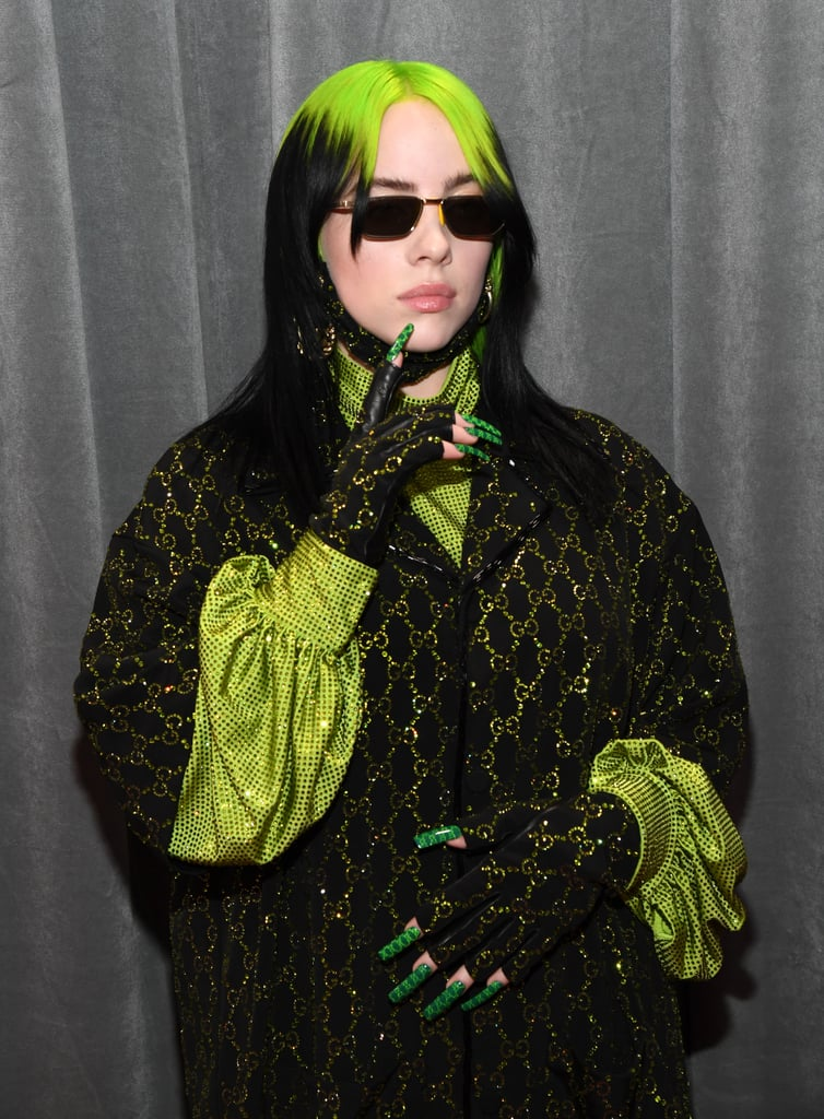 Billie Eilish arrived at the 2020 Grammy Awards on Sunday looking like money both figuratively and literally. The 18-year-old singer and nominee wore a head-to-toe green Gucci outfit consisting of bedazzled, logo-emblazoned separates layered over a sequin long-sleeve turtleneck. Styled by Samantha Burkhart, the edgy outfit was complemented by metallic sneakers, fingerless gloves, tiny sunglasses, and gold hoop earrings. Not only did the lime green look match Billie's dyed roots, but it also doesn't not remind us of Nickelodeon slime. (Are we right or .  . . are we right?) See pictures of Billie hitting the red carpet ahead, and then check out what everyone else wore to the star-studded award show.       Related:                                                                                                           Sorry, Lizzo Couldn't Carry a Tiny Bag With This Badass Furry Stole