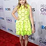 Chloë Moretz opted for a girly Simone Rocha Spring 2013 dress in a high-wattage hue.