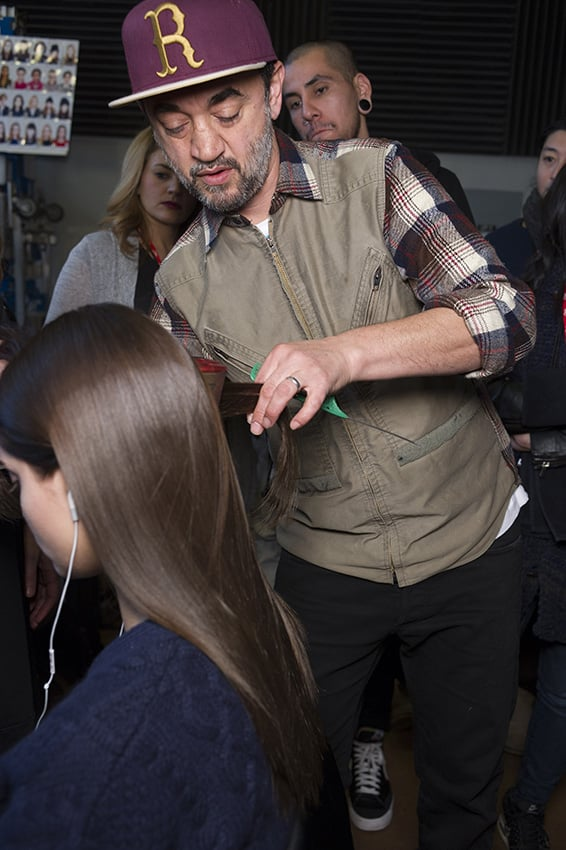 Next, use straightening irons through the hair to create a smooth polished look.