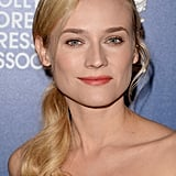 Now that Diane Kruger has done the side ponytail, it's officially in style. The over-the-shoulder look is ideal for the dog days of Summer, and we want to steal her lovely pumpkin lip hue, too.