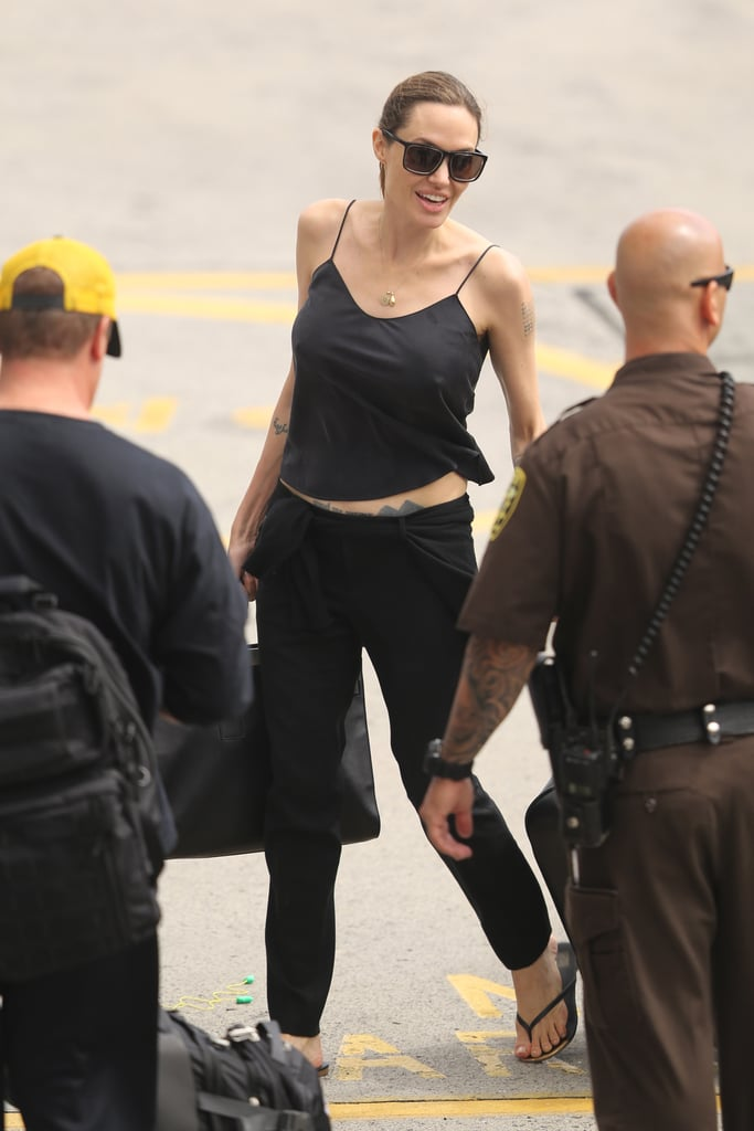 Angelina Jolie boarded a plane in Hawaii to return to LA.