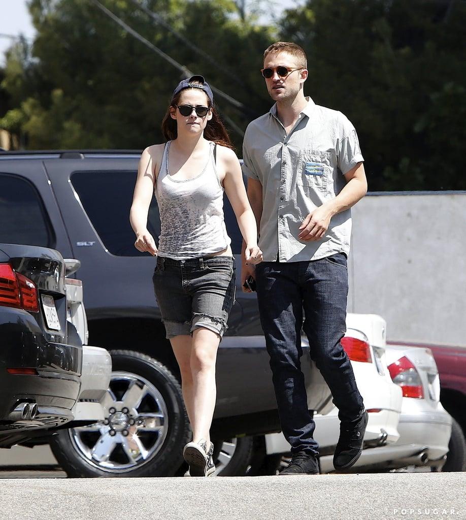 Robert Pattinson and Kristen Stewart both wore sunglasses.