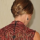 Stacy finished the look with Neil Lane jewel-drop earrings — and we get a closer glimpse of the delicate beading from the back.