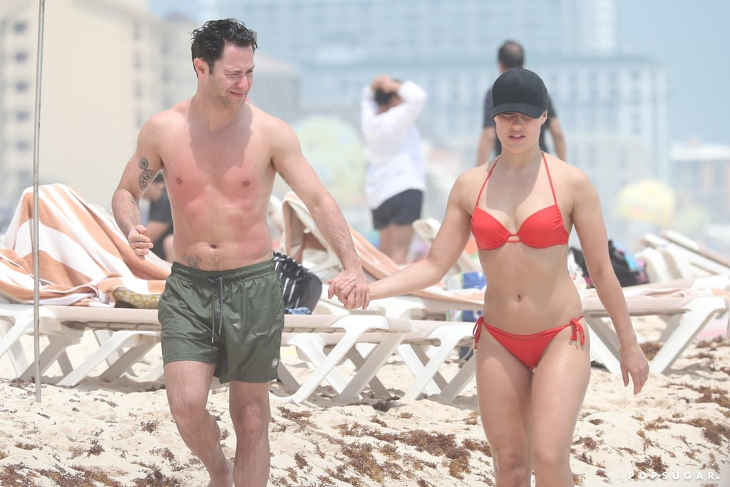 """Dancing With the Stars isn't returning this Spring, and Emma Slater and Sasha Farber are clearly enjoying the extra free time. The pro dancers and real-life couple recently soaked up the sun during a romantic vacation in Cancun, Mexico. On Sunday, the pair were spotted showing sweet PDA as they walked alongside the beach hand in hand. While Sasha gave a glimpse of his tattoos as he went shirtless, Emma rocked a red hot bikini. After showing some sweet PDA in the water, the two snapped a cute selfie together for Instagram Stories.  Their fun-filled vacation comes a year after they tied the knot. The couple first got engaged in October 2016 during an episode of DWTS after performing a special rendition of Bruno Mars's """"Just the Way You Are."""" Following their dance, Sasha gave the audience (and Emma) a sweet surprise when he got down on one knee and proposed. The two eventually said """"I do"""" in front of family and friends on March 25, 2018. See more of their vacation ahead!       Related:                                                                                                           Emma Slater and Sasha Farber Have DWTS to Thank For Their Adorable Romance"""