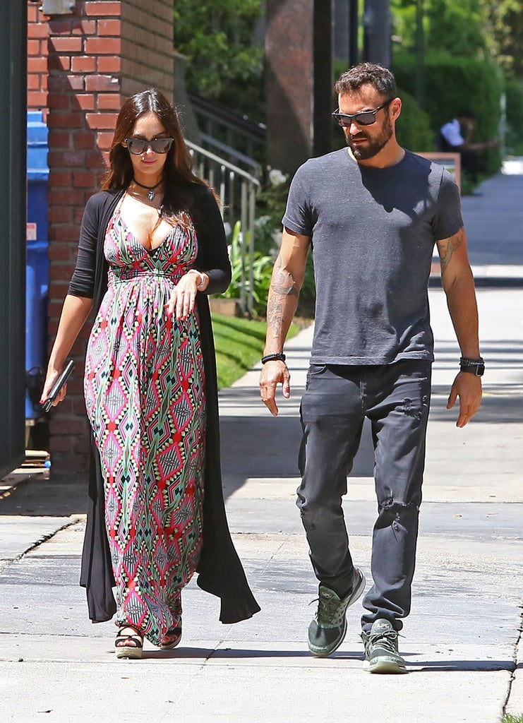 "Megan Fox showed off her baby bump in a printed maxi dress while grabbing lunch with her estranged husband, Brian Austin Green, in LA on Tuesday. The pair didn't show any PDA but walked side by side down the street and chatted with each other. Megan made headlines on Monday night when she revealed her growing belly on the red carpet at CinemaCon; the Teenage Mutant Ninja Turtles star linked up with her costar Will Arnett and posed for photos in a tight-fitting black dress. It will be the third child for Brian and Megan — the two are already parents to sons Noah and Bodhi — and Megan made sure to address rumors surrounding the paternity of her unborn child via Instagram on Tuesday by sharing a collage of pictures with Will, Shia LaBeouf, and her New Girl costar Jake Johnson captioned ""#NotTheFather."" News of Megan's pregnancy came as a surprise to most, especially considering that she and Brian announced their separation back in August. The couple had been married for five years and dating for nearly 11, and Megan cited their separation date as June 15, 2015. After Megan put her baby bump on display, E! reported that Brian is the father of her child and that the couple will likely postpone their divorce proceedings; according to a source close to the couple, the divorce ""will likely be put on hold for a while,"" and, ""This pregnancy was not planned, but when they found out they were extremely happy."" Keep reading to see Megan and Brian's day out, then check out more celebrities who are expecting babies this year."