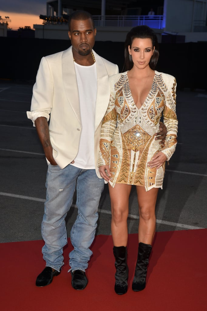 """Kanye West posed with a Balmain-clad Kim Kardashian at the Belvedere-sponsored premiere of his Cruel Summer in Cannes this evening. Jay-Z and Leonardo DiCaprio's pal Lukas Haas were also on hand for the event, which was Kanye's first at the Cannes Film Festival. Kanye said of the production, """"It's actually kind of surreal seeing the film come to fruition right here. I can dream one day that this will be the way that one day people will watch movies. I want to change what entertainment experiences are like."""" Kim and Kanye spent the day together in the South of France and stuck by each other's side for tonight's bash as well. We spotted them showing serious PDA and kissing throughout the party. Jay-Z, meanwhile, snacked on sushi and bobbed his head when the DJ played Beyoncé's """"Love on Top."""" Some of Jay-Z's own jams provided the soundtrack for the big night as well."""