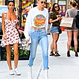 """Gigi brought it back to the '90s with a """"Property of Nickelodeon Studios Crew"""" crop top. She wore it with Frame jeans and her trusty pair of Stuart Weitzman Clingy boots."""