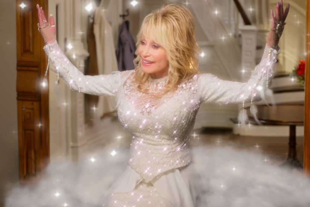 """As much as I like to bill myself as a relatively impassive person, I'm a sucker for two things: the holiday season and Dolly Parton. So imagine the genuine joy I felt when Netflix dropped the official trailer for Dolly Parton's Christmas on the Square on Oct. 22. The one-minute clip begins with Parton softly crooning, """"Christmas is a time for caring, being at your best / Christmas is a time for sharing, knowing you've been blessed"""" — a strategy I'm convinced is directly targeting me and my tear ducts. It then teases the events that unfold when a woman named Regina Fuller (Christine Baranski) decides to sell a small town without any regard for how it'll affect residents. Perhaps a visit from an angel (Parton) will change her mind. The musical, which was directed and choreographed by the iconic Debbie Allen, will feature 14 songs by Parton. Jenifer Lewis, Treat Williams, Josh Segarra, and Jeanine Mason are also among the stars set to give us a jolly good time. Look ahead to watch the trailer for Dolly Parton's Christmas on the Square, then check out all of the film's first-look photos before it drops on Nov. 22!      Related:                                                                                                           Netflix Is Starting the Holidays Early With These New Movies and TV Shows"""
