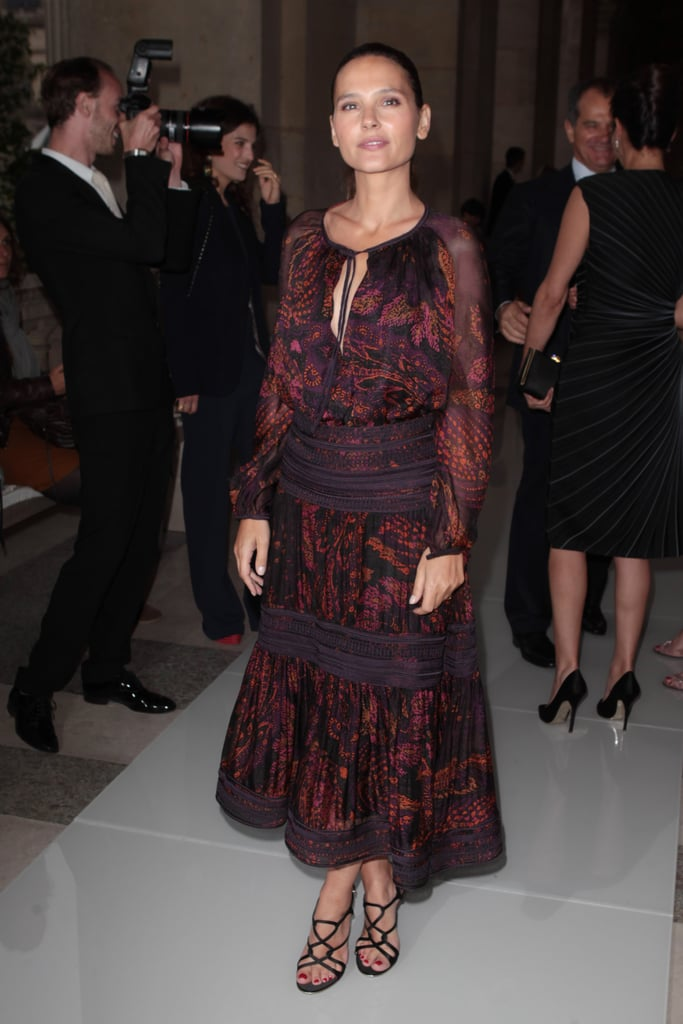 Virginie Ledoyen wore a long patterned dress to the Salvatore Ferragamo Resort collection show in Paris.