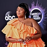 Lizzo's Miniature Valentino Bag and Orange Dress at the AMAs