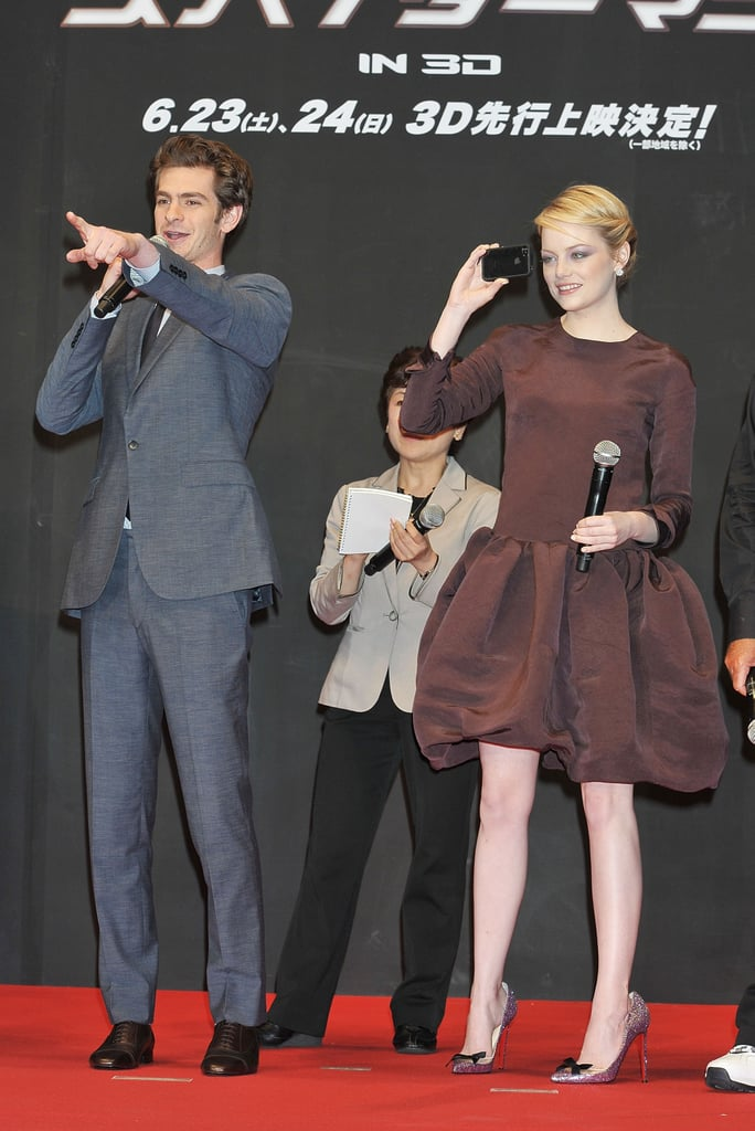 Emma Stone captured the crowd on her iPhone as Andrew Garfield spoke at The Amazing Spider-Man premiere in Japan.