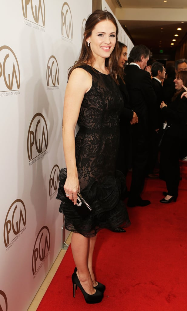 Jennifer Garner opted for a black Oscar de la Renta lace dress with ruffle detailing along the hemline, finished with black satin Brian Atwood pumps.