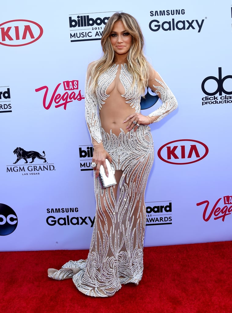 Jennifer Lopez followed up her nearly nude Met Gala appearance earlier this month with another skin-baring look at the Billboard Music Awards in Las Vegas on Sunday night. She wore a sheer, beaded gown and posed solo on the red carpet on her way into the show, which was held at the MGM Grand Garden Arena. J Lo will soon be spending even more time in Vegas, since she recently announced her plans for residency at the Planet Hollywood Resort and Casino. She'll start performing in January 2016, but until then, check out her hottest moments over the years.