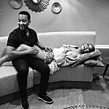Chrissy kept it casual in a white bodysuit, denim cutoffs, and a loose sweater in her pregnancy announcement shot on Instagram.