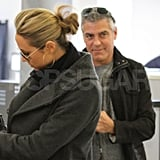 George Clooney smiled behind Stacy Keibler at LAX.
