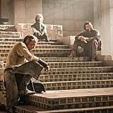 Jorah (Iain Glen), Tyrion (Peter Dinklage), and Daario (Michiel Huisman) sit around, probably wondering when Daenerys is coming home.