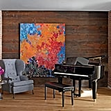 Wide-plank wooden walls add loads of warmth to John's piano room.
