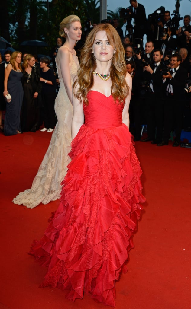 Isla Fisher showed she wasn't afraid of ruffles in her red Oscar de la Renta gown, which she accessorized with a choker statement necklace.
