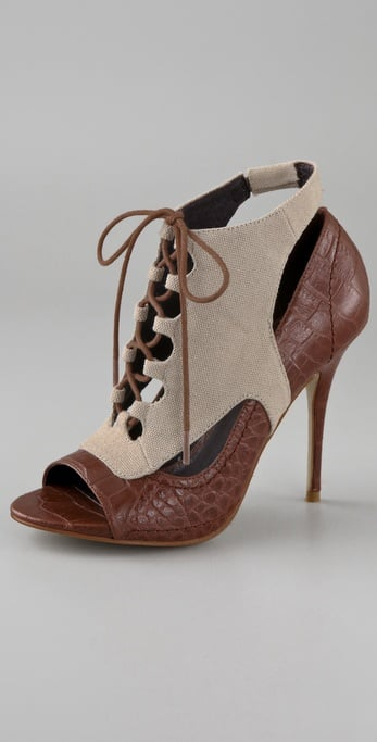 Canvas and crocodile meet in this Elizabeth and James Bootie ($375), quite brilliantly.