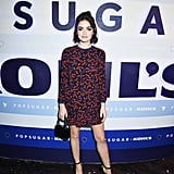 Lucy Hale styled her POPSUGAR Flounce-Hem Mini Dress ($60) with black heels and an adorable clutch — the look is perfect for a party!