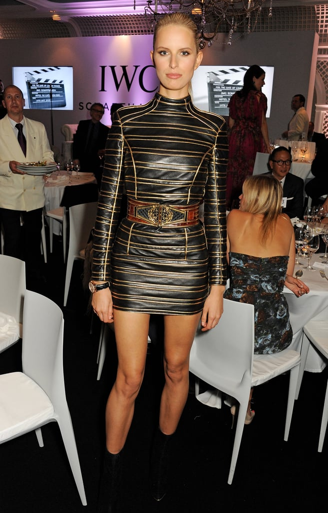 Karolina Kurkova put her long legs on display in a black-and-gold striped long-sleeved minidress at the For the Love of Cinema party.