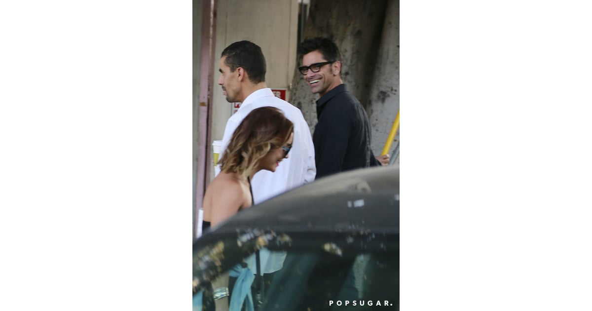 Vanessa Hudgens and John Stamos smiled when they spotted ...