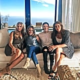 Caitlyn Jenner posed in her living room with pal Candis Cayne and designers Lori Margolis and Lawson Taylor on a Homenature sofa.