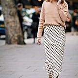 A Beige Jumper, Maxi Check Skirt, and Gold Heels