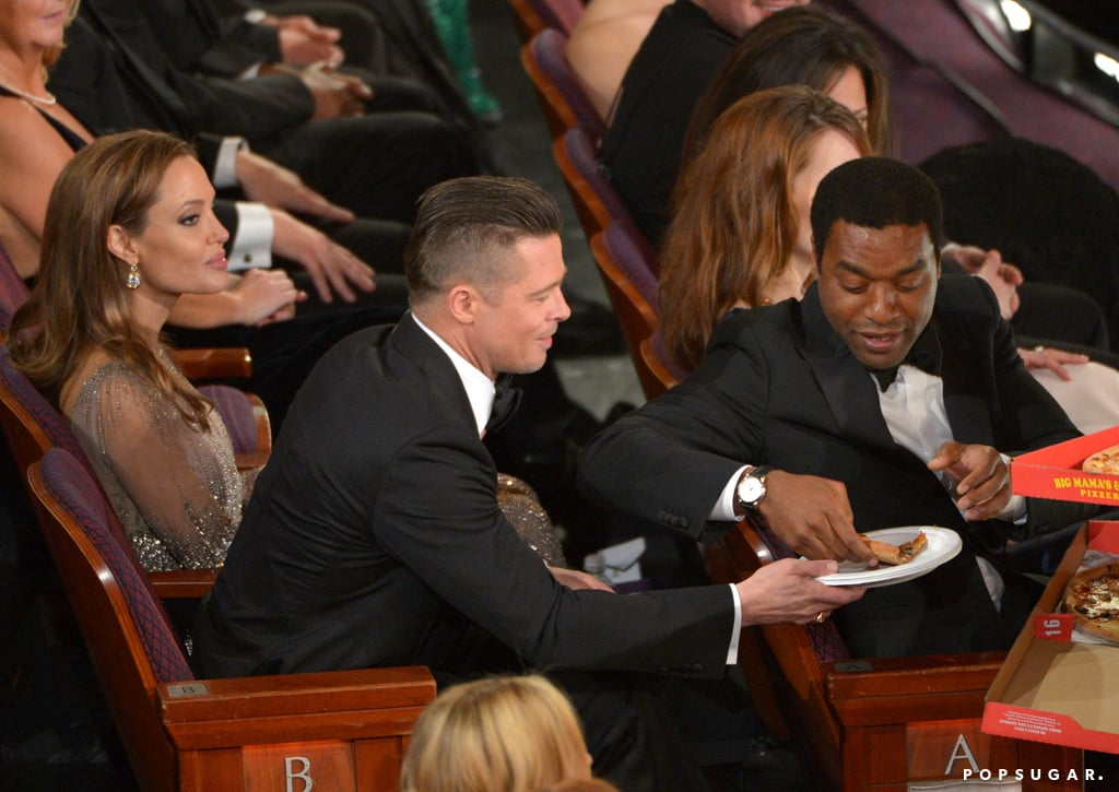 Brad Pitt got a pizza from Chiwetel Ejiofor.