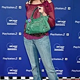 Still sticking to a casual vibe, Anned showed off an emerald Balenciaga bag in October 2004.