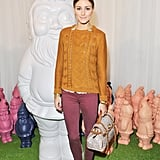 Olivia Palermo played with contrasting hues on her pullover and her red Current/Elliott skinnies — with a Mulberry bag in tow at the label's Spring show.