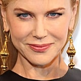 Nicole Kidman wore ornate gold earrings.