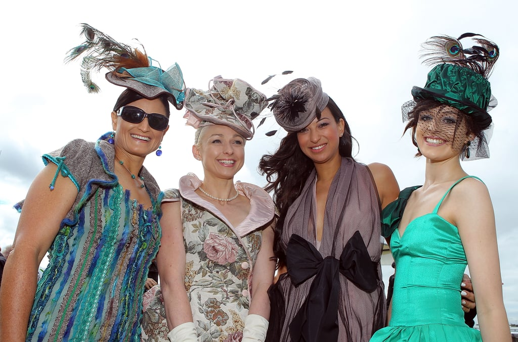 A bit of wind won't deter these hatted ladies.