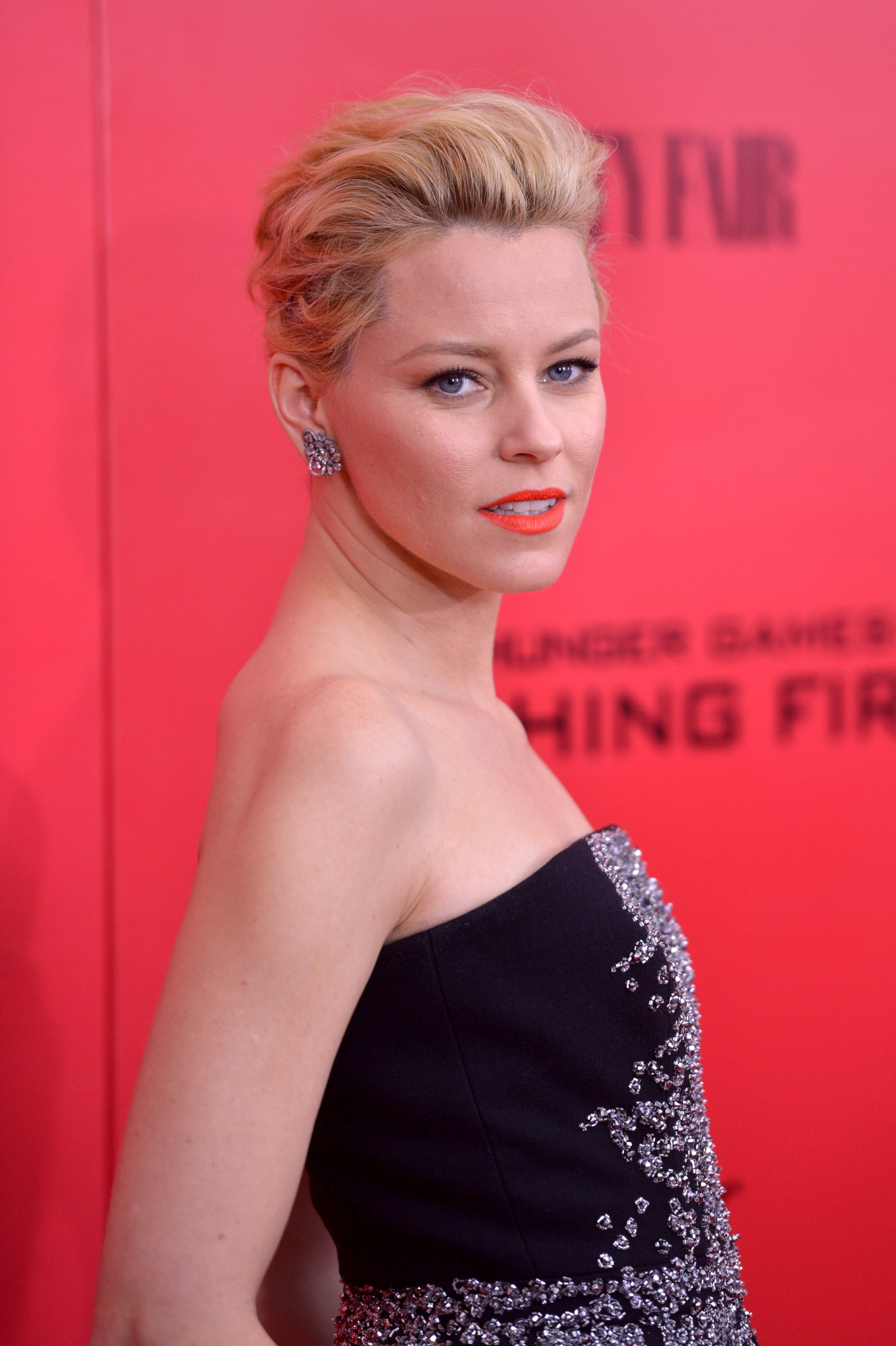 Elizabeth Banks went with an orange lip and pompadour twist for the Hunger Games red carpet in New York.