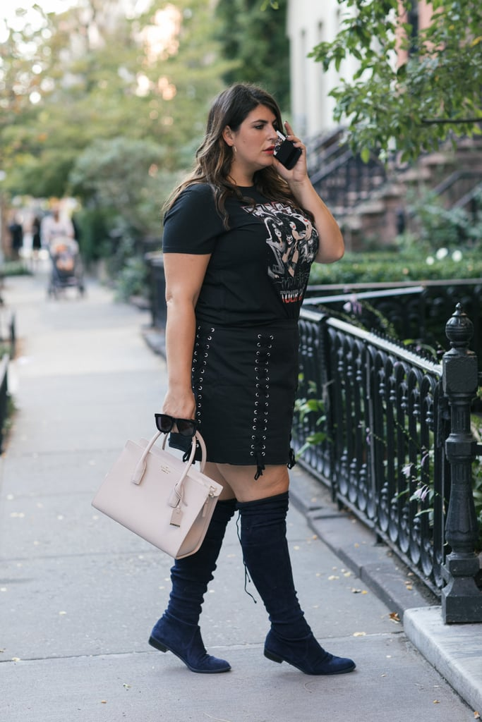 Olivia Munn looks drop-dead sexy thanks to a monochromatic color palette and killer accessories. Start with an edgy black mini, like this one by Forever 21 (available sizes 0X-3X), and over-the-knee-boots (I love Stuart Weitzman's Lowland pair, available up to a size 12W). Add oversize hoop earrings and a classic concert tee for an I'm-with-the-band feel. Finally, a structured, ladylike bag, like this one by Kate Spade, is the perfect antidote to all the sexy!