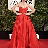 Zooey Deschanel maintained her retro charm in a red strapless Oscar de la Renta confection, only adding oversize pearl accessories into the mix for a classic interjection.