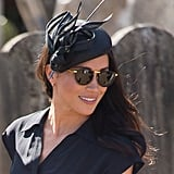 Meghan Markle Wearing Philip Treacy to the Wedding of Charlie van Straubenzee in August 2018