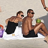 Beyoncé Knowles and Jay-Z slipped into swimwear and relaxed on a white sandy beach in St. Barts.