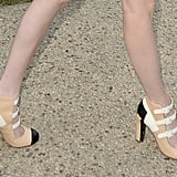 Her shoes were classic Chanel with the mix of white, nude, and black.