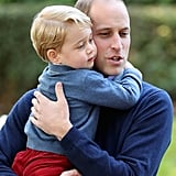 William hugged George tightly during a children's party for military families.