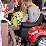 Charlize Theron held Jackson Theron on her lap as he got a haircut.