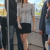 Emma Watson got ready for her close-up in Cannes in a white lace top and a black miniskirt, completed with a pair of dainty black pumps -- all by Louis Vuitton.