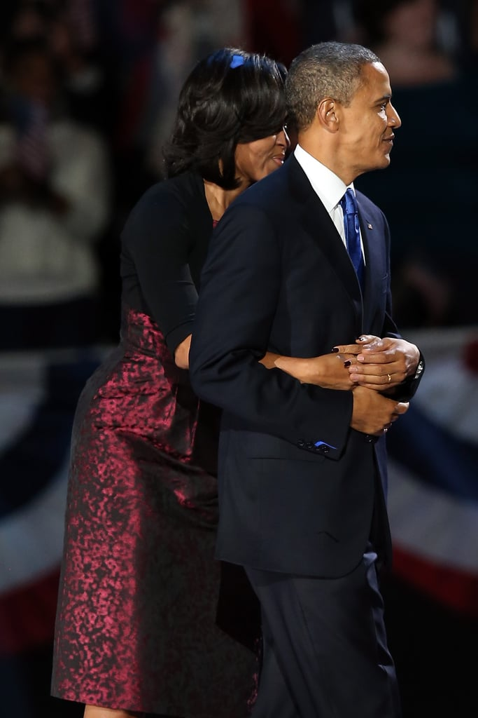 Michelle Obama looked relieved as she hugged Barack on election night.