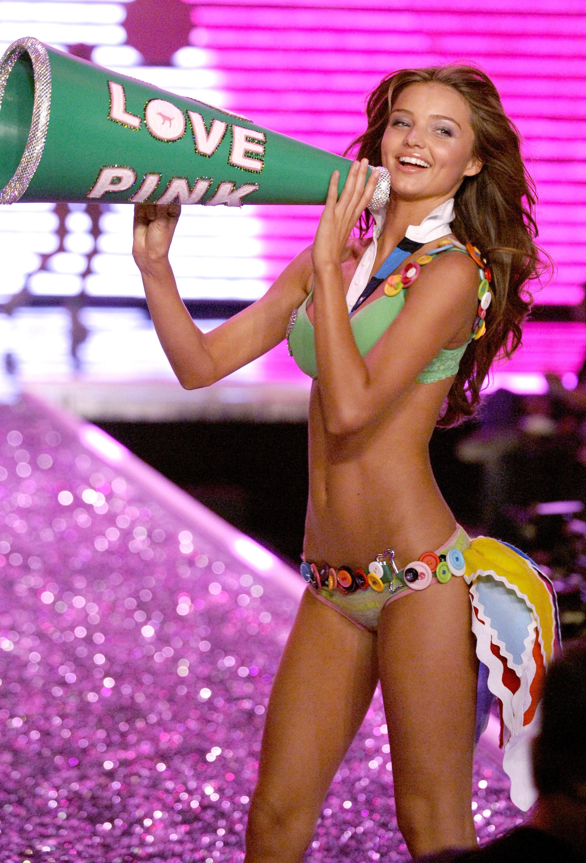 Miranda Kerr carried a giant megaphone during her turn on the runway in 2006.
